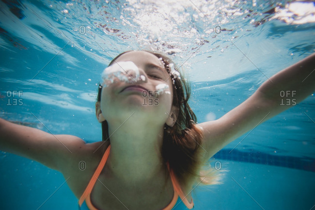 Underwater view of girl in a swimming pool