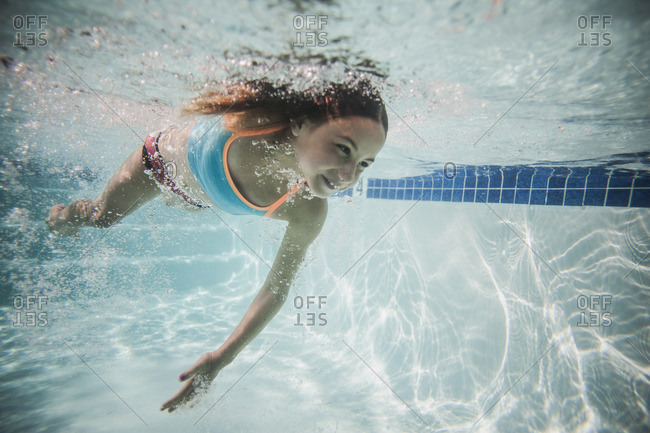 Underwater view of a girl swimming in a pool