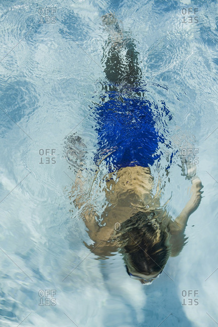 Overhead view of a boy swimming in a pool