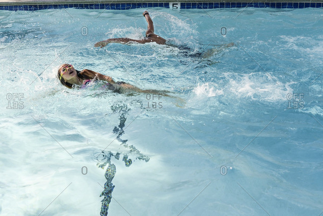 Two children swimming in a pool