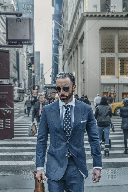 New York City, New York - February 22, 2016: Businessman in a suit walking on 5th Avenue