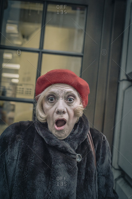 New York City, New York - February 22, 2016: Lady looking shocked wearing a red beret
