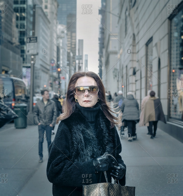 New York City, New York - February 22, 2016: Lady in Sunglasses and fur coat on 5th Avenue