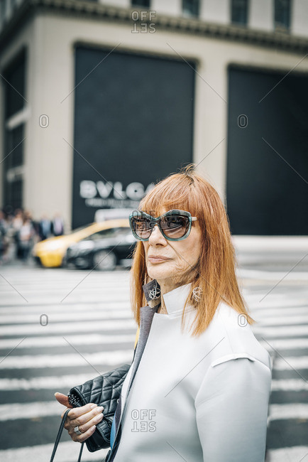 New York City, New York - February 22, 2016: Lady with big sunglasses on 5th Avenue