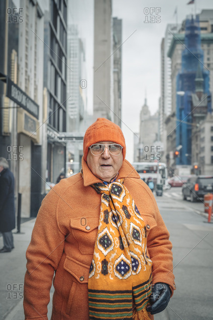New York City, New York - February 9, 2016: Older man dressed head to toe in orange on 5th Avenue, New York City