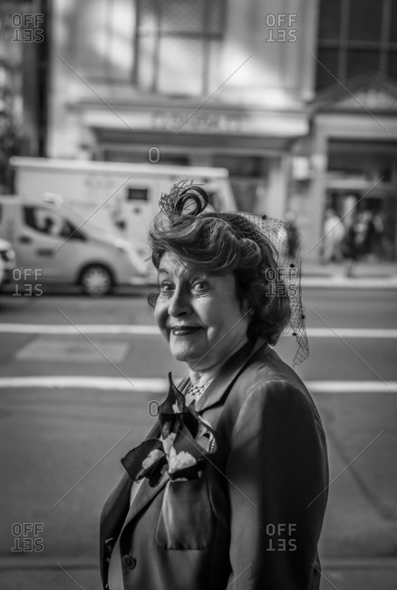 New York City, New York - February 22, 2016: Lady smiling with hat in black and white