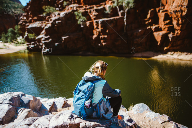 Glen Helen Gorge, Northern Territory, Australia - August 1, 2016: Woman looking out over the Glen Helen Gorge in Australia