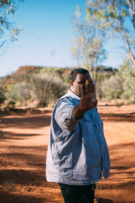 Australia - August 2, 2016: An aboriginal man teaches travellers about traditional weaponry customs