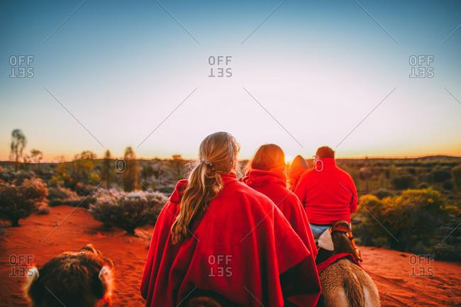 Camel ride at sunrise in Australia
