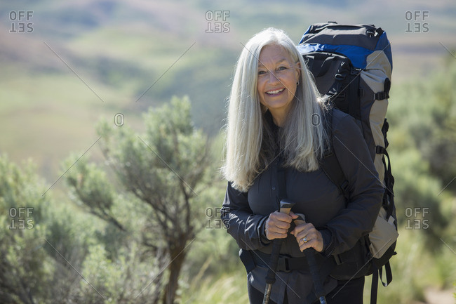 Older Caucasian woman hiking with backpack