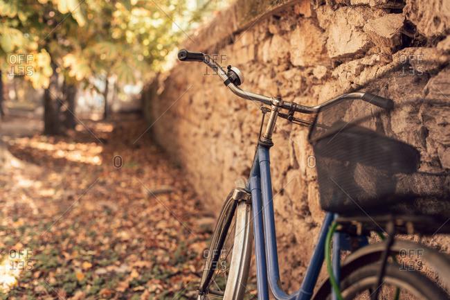 A bike leaning against stone wall