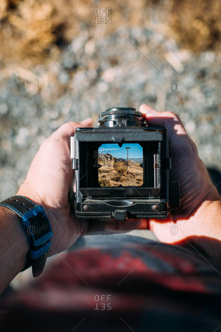 Landscape through the viewfinder of an old fashioned medium format camera