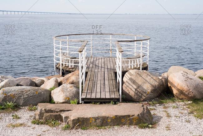 A circular wood pier along a harbor