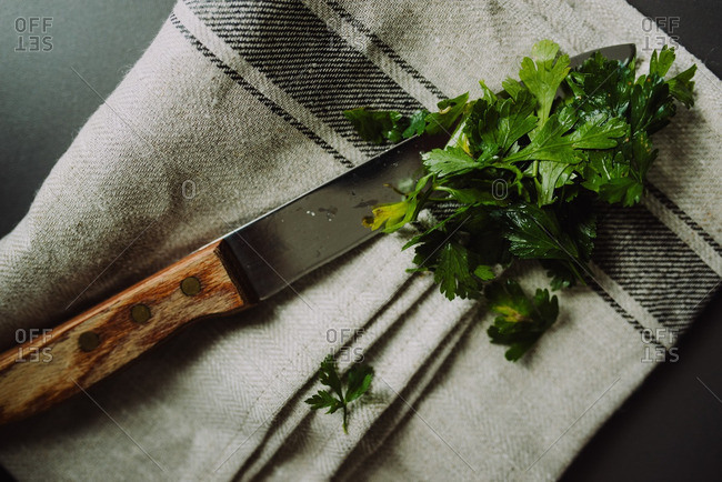 Parsley and knife on a towel