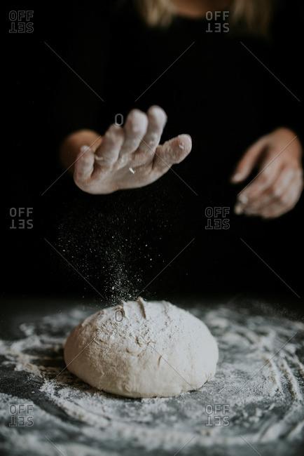 Woman patting a ball of dough