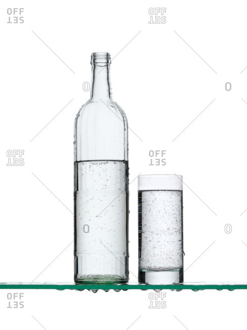 Sparkling water in a bottle and a glass