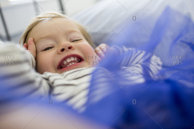 Laughing Caucasian baby girl wearing blue tutu