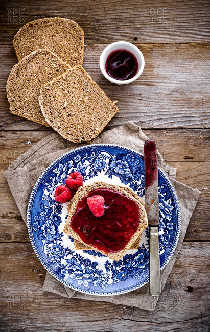 Slice of homemade whole wheat bread with raspberry jam