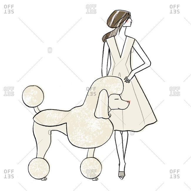 Stylish woman by a poodle