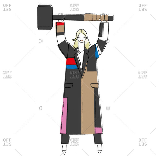 Woman in coat holding large mallet