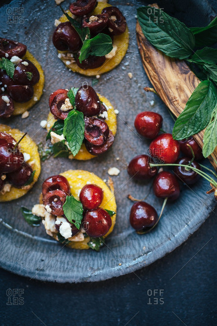 Polenta rounds with cherries and mint