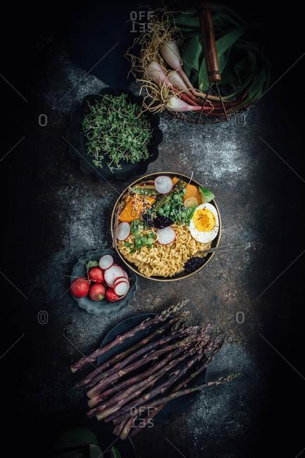 Bowl of ramen arranged with spring vegetables