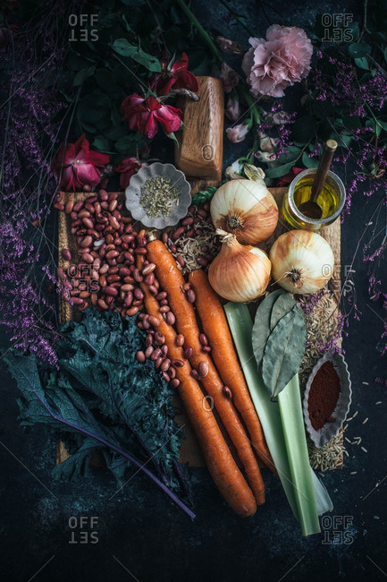 Overhead view of ingredients for hearty vegetarian dish arranged on cutting board