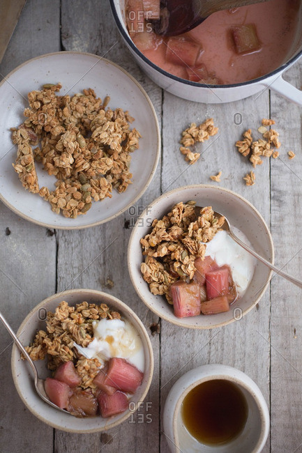 Bowls of yogurt with granola and rhubarb
