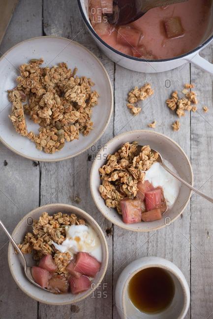 Bowls of yogurt with granola and rhubarb