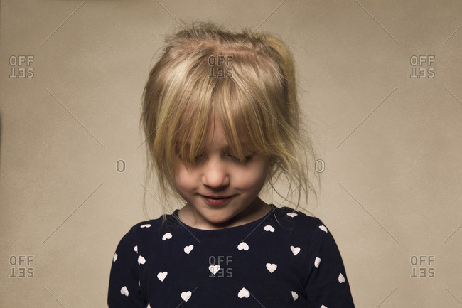 Girl looking down in studio shot