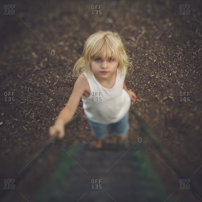 Girl at bottom of playground equipment