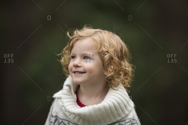 Girl with curly strawberry blonde hair