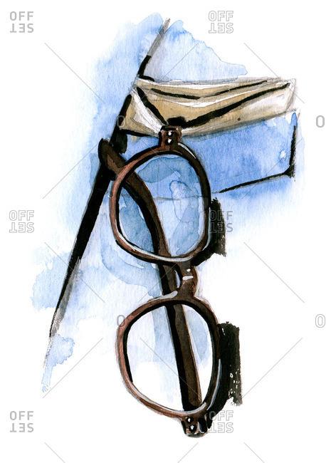 Eyeglasses hanging from a man's pocket