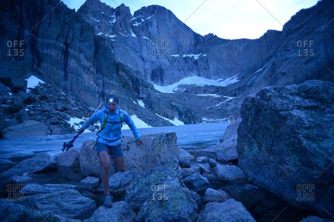 Hiker exploring Chasm Lake, Rocky Mountains National Park, Colorado