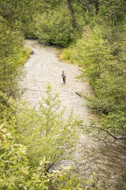 High angle view of man fly fishing in river