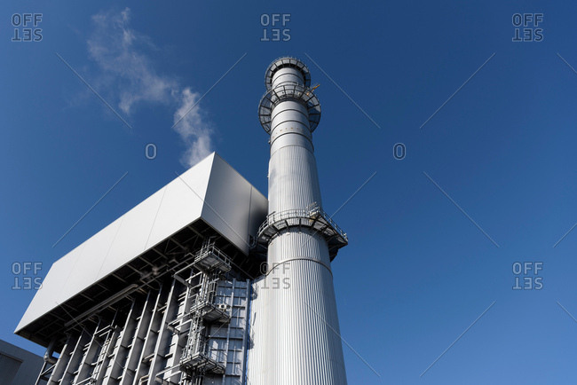 Low angle view of boiler and stack at gas-fired power station