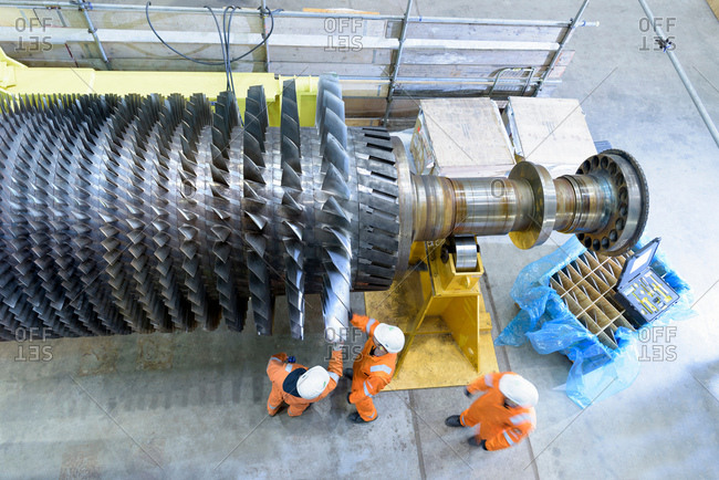 Overhead view of gas turbine under repair in gas-fired power station