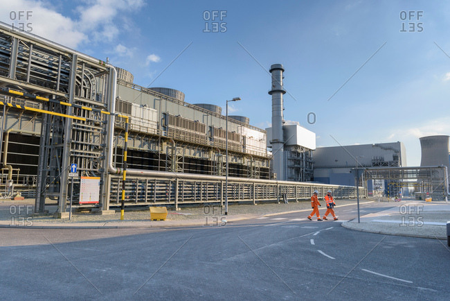 Workers walking through gas-fired power station