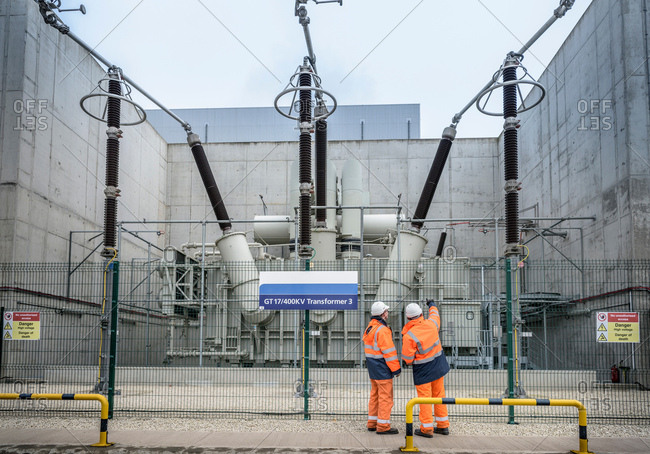 Workers with 400KV transformer in gas-fired power station