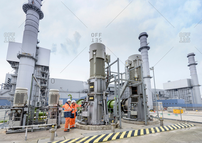 Workers at pumping station at gas-fired power station