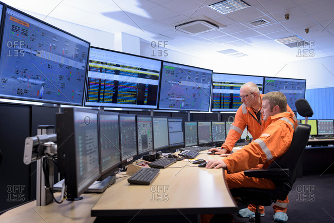 Workers in control room of gas-fired power station