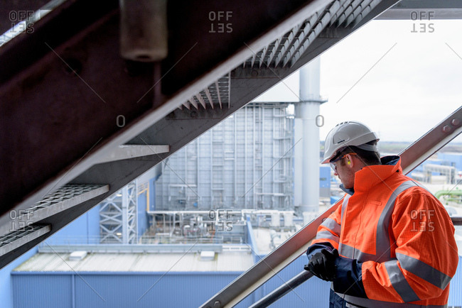Worker looking out on to gas-fired power station