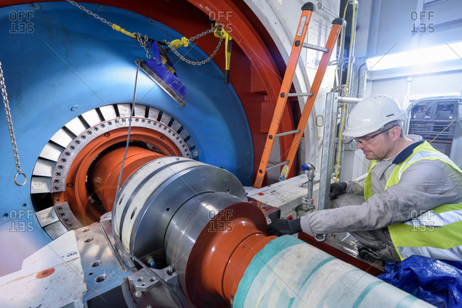 Engineer inspecting equipment in gas-fired power station