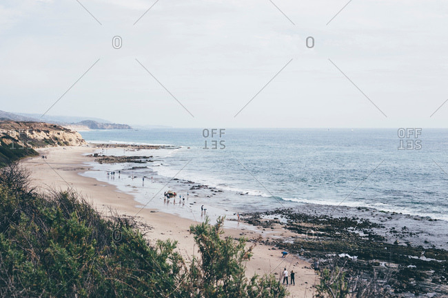 Elevated distant view of people on beach, Crystal Cove State Park, Laguna Beach, California, USA