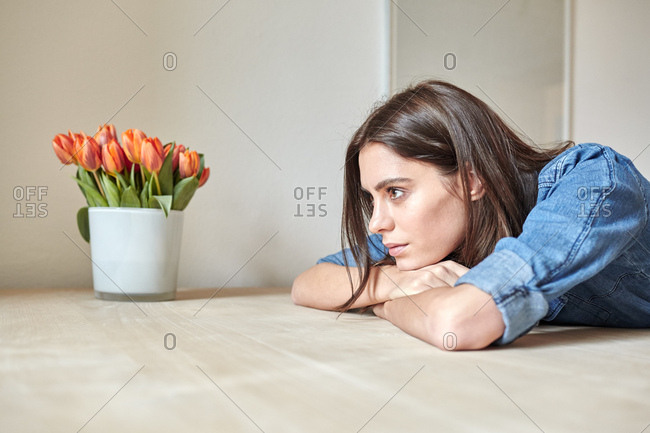 Young woman leaning forward on dining table