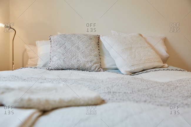Surface level view of traditional bedding with cushions and pillows