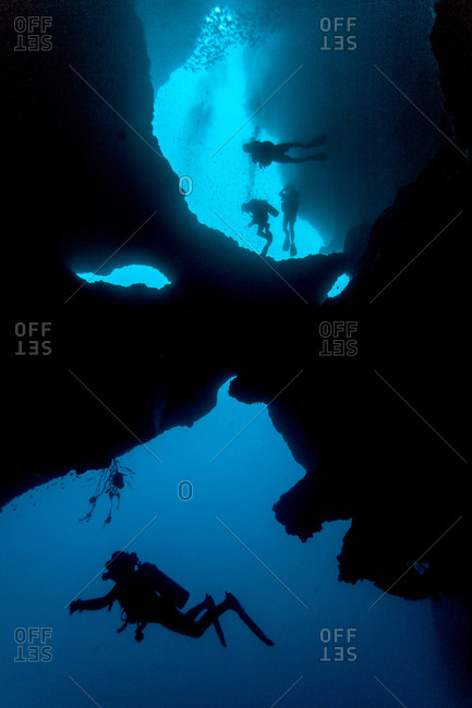 Diver swimming in cave system, Moalboal, Cebu, Philippines