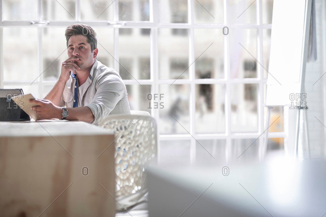 Businessman contemplating in office