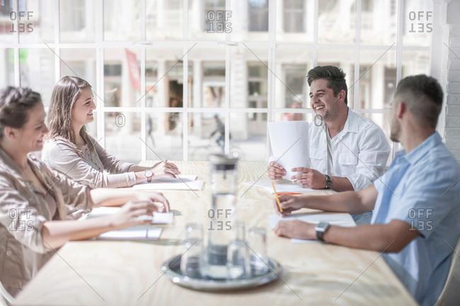 Businessmen and businesswomen brainstorming in loft office