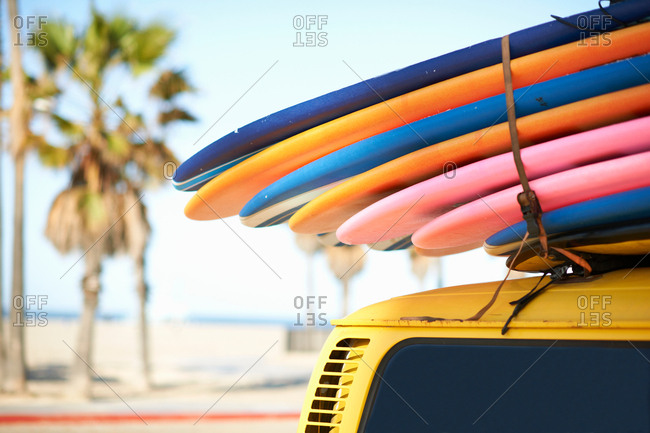 Multi-colored surfboards tied onto vehicle, Venice Beach, Los Angeles, USA